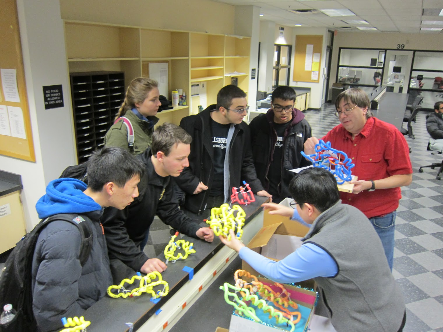 Teams are scored on protein models built in advance, smaller models built during the competition, and a written exam